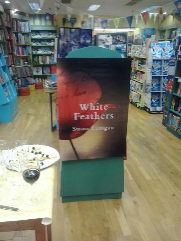 large poster of White Feathers on display!